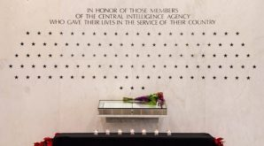 A Sacred Commitment: Soon after their deaths, seven ashen stars were chiseled into the smooth white marble of the CIA Memorial Wall, joining a constellation of what is now 111 stars commemorating each of the Agency's fallen officers. Their names were also etched into the Book of Honor, each beside a 23-carat gold leaf star.
