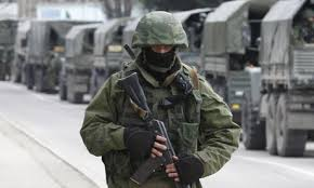 A weary Russian infantryman protects the left flank of a vehicle convoy moving through western Crimea, Ukraine in 2014.