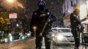Elite members of France's anti terrorism police outside Charlie Hebdo office the night following the attack.