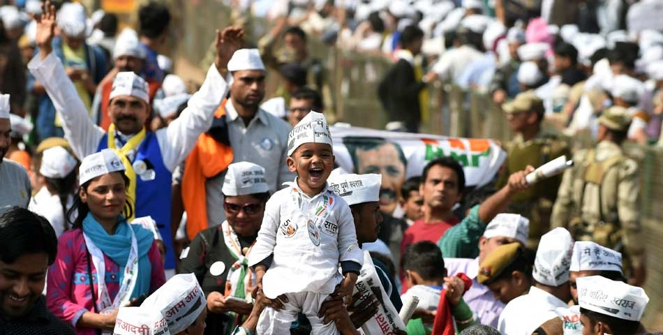 AAP Activists witnessing the swearing-in ceremony of Mr. Arvind Kejriwal in Ramalila Maidan on 14-02-2015.