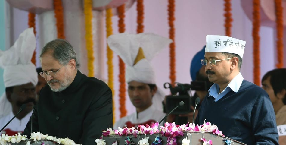 Lieutenant Governor Mr. Najeeb Jung administering the oath of to AAP Leader Mr. Arvind Kejriwal as the Chief Minister of Delhi on 14-02-2015.