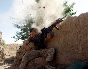 ON THE DEFENSIVE: Taliban fighters almost blow the head of this young Marine in Afghanistan.