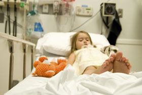 A small child waits in hospital in Maine...