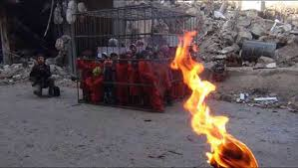 A picture posted by Pegida on Twitter showing ISIS threatening to burn children lock in a cage.
