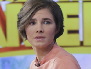 Image: Amanda Knox prepares to leave the set following a television interview Friday in New York.