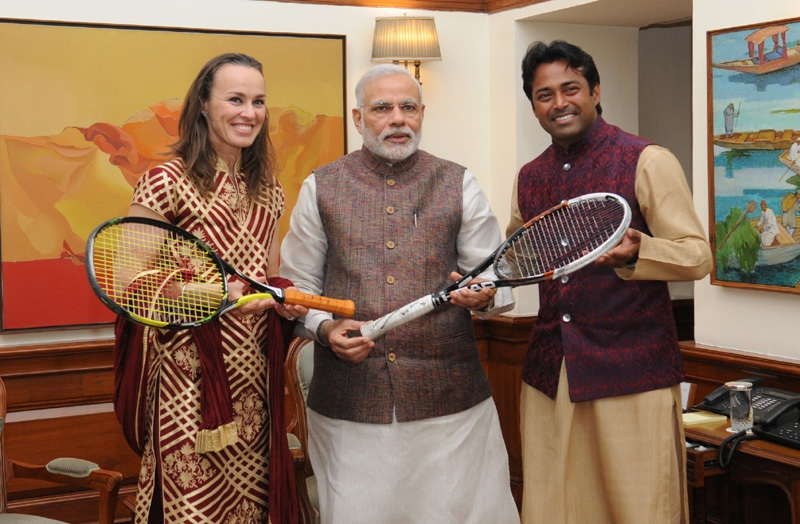 The Tennis Players, Martina Hingis and Leander Paes presenting autographed racquets with which they played Australia Open Mixed Doubles Finals to the Prime Minister, Mr. Narendra Modi, in New Delhi on March 05, 2015.