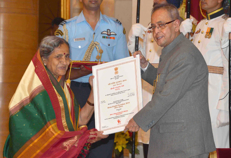 The President, Mr. Pranab Mukherjee presenting the 'Mata Jijabai Award' to Mrs.Chandraprabha Boke (Maharashtra), at the presentation of Stree Shakti Puraskar 2014 on the occasion of International Women's Day, at Rashtrapati Bhavan, in New Delhi on March 08, 2015.