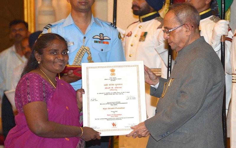 The President, Mr. Pranab Mukherjee presenting the Nari Shakti Award to Mrs.P. Kousalya (Tamil Nadu), at the presentation of Stree Shakti Puraskar 2014 on the occasion of International Women's Day, at Rashtrapati Bhavan, in New Delhi on March 08, 2015.