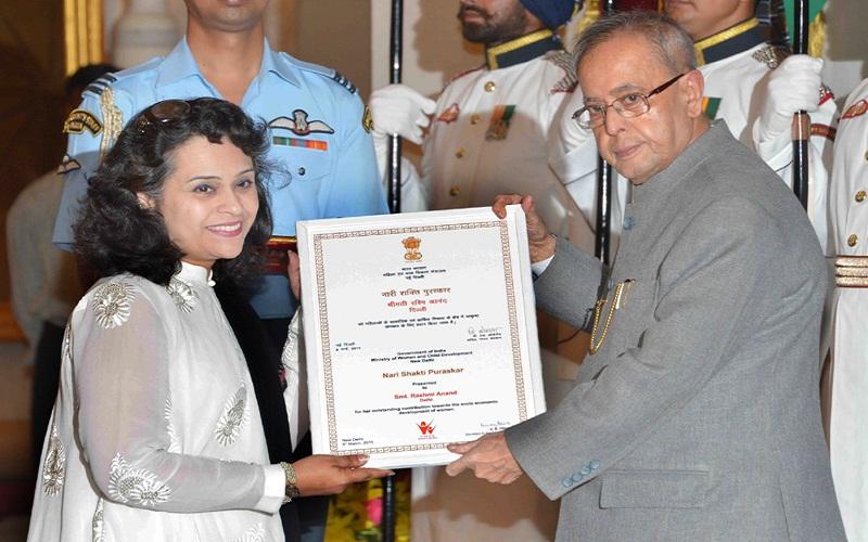 The President, Mr. Pranab Mukherjee presenting the Nari Shakti Award to Mrs. Rashmi Anand (Delhi), at the presentation of Stree Shakti Puraskar 2014 on the occasion of International Women's Day, at Rashtrapati Bhavan, in New Delhi on March 08, 2015.