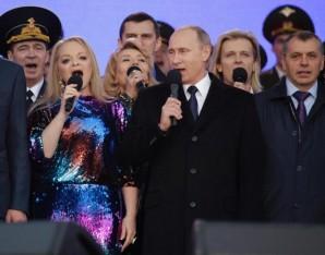 Putin sings at celebration.