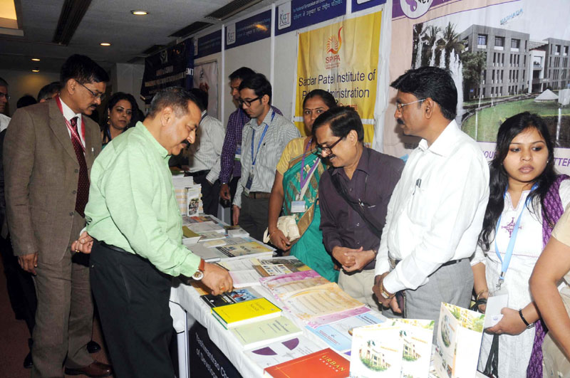 The Minister of State for Development of North Eastern Region (I/C), Prime Minister's Office, Personnel, Public Grievances & Pensions, Department of Atomic Energy, Department of Space, Dr. Jitendra Singh visiting the exhibition at the inauguration of the National Symposium on Excellence in Training, in New Delhi on April 11, 2015. The Secretary, DoPT, Mr. Sanjay Kothari is also seen.