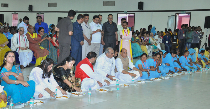 """The Union Home Minister, Mr. Rajnath Singh having meals with a group of Dalit women, during a get-together on the sidelines of the National Seminar on """"Untouchability no more"""", in New Delhi on April 13, 2015."""