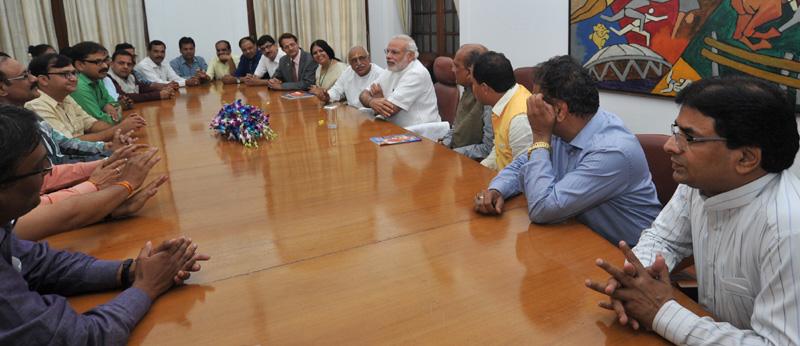 A delegation of media-persons from Madhya Pradesh calling on the Prime Minister, Mr. Narendra Modi, in New Delhi on April 29, 2015.
