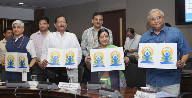 The Union Minister for External Affairs and Overseas Indian Affairs, Mrs. Sushma Swaraj along with the Minister of State for AYUSH (Independent Charge) and Health & Family Welfare, Mr. Shripad Yesso Naik launching a logo for the International Day for Yoga, in New Delhi on April 29, 2015. The Secretary, Ministry of AYUSH, Mr. Nilanjan Sanyal is also seen.