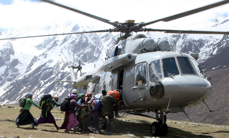 Local Nepalese and Army persons being evacuated by An Indian Air Force (IAF) Mi-17 V5 helicopter of directions of Nepalese authority as part of relief & rescue operations following a recent massive earthquake in Nepal.