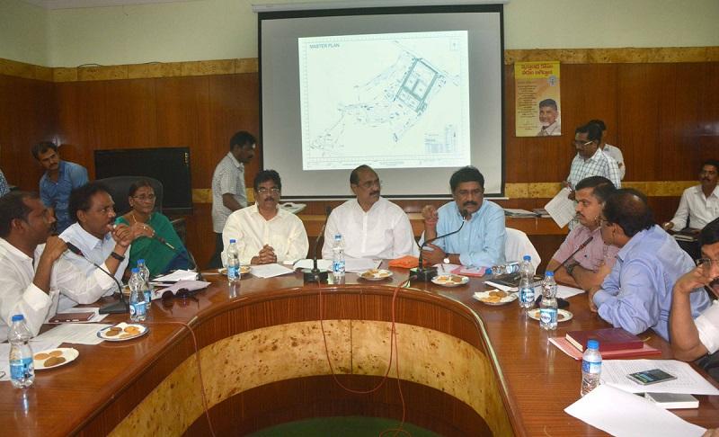 Health Minister of Andhra Pradesh Mr. Kamineni Srinivas Reviewing Health issues at Collectorate Meeting Hall in Visakhapatnam on 16-05-2015. HRD Minister Mr. Ganta Srinivasa Rao is also seen.