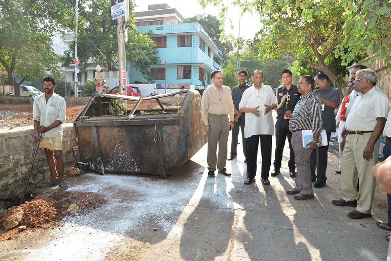 Mr. ESL Narasimhan, Governor of Telangana/ Andhra Pradesh, participating in Swachh Hyderabad Programme at Anand Nagar Colony and Venkataramana Colony on the second day on 17-05-2015. The Governor interacted with the local residents while participating in the programme. The GHMC and other officials are also seen.