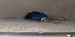 Homeless veteran in Phoenix, Arizona sleeping on a card board box May 2015.