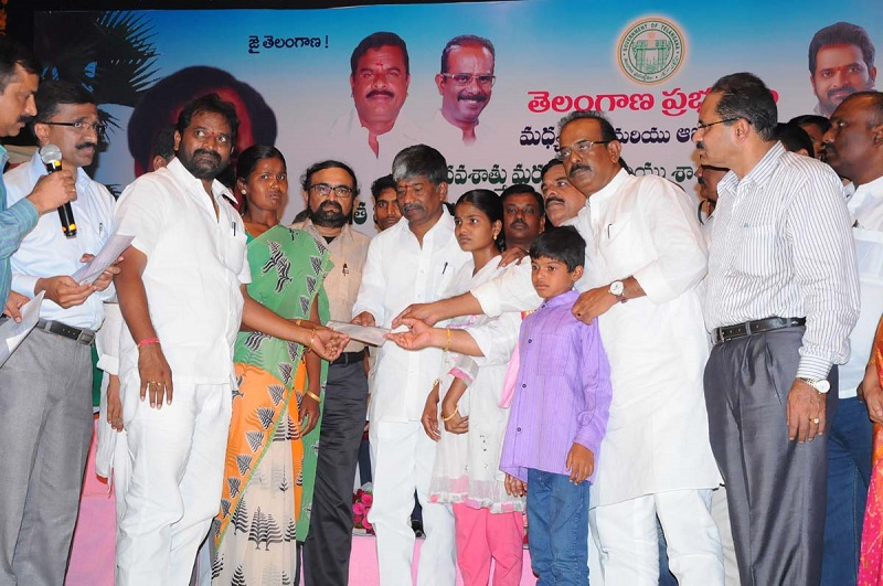 Mr. T Padma Rao Goud, Minister for Excise & Prohibition participating in a Programme of handing over Exgratia to the bereaved toddy tappers families as well as permanent disabled toddy tappers of various districts of Telangana State at Ravindra Bharathi, Hyderabad on 04.05.2015.