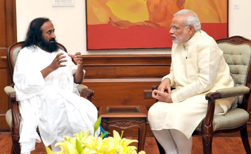 Spiritual Leader and Founder of the 'Art of Living Foundation', Sri Sri Ravi Shankar calls on the Prime Minister, Mr. Narendra Modi, in New Delhi on June 11, 2015.