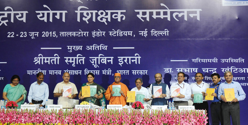 The Union Minister for Human Resource Development, Mrs. Smriti Irani releasing the syllabus and course material for class VI to X on yoga education (NCERT), and training module for teacher education programme, at the inauguration of the Rashtriya Yoga Shikshak Sammelan, in New Delhi on June 22, 2015. The Deputy Chief Minister, Delhi, Mr. Manish Sisodia, the Secretary, School Education and Literacy, Dr. Subash Chandra Khuntia and other dignitaries are also seen.