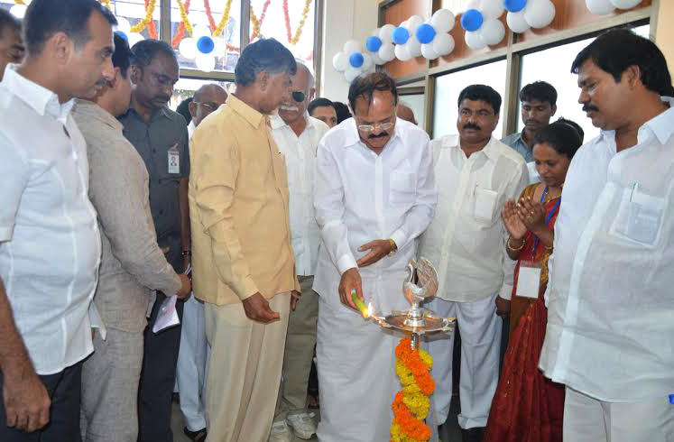 The Union Minister for Urban Development, Housing and Urban Poverty Alleviation and Parliamentary Affairs, Mr. M. Venkaiah Naidu lighting the lamp at the opening ceremony of KADAPA Airport, Andhra Pradesh on June 07, 2015. The Union Minister for Civil Aviation, Mr. Ashok Gajapathi Raju Pusapati and the Chief Minister of Andhra Pradesh, Mr. N. Chandrababu Naidu is also seen.