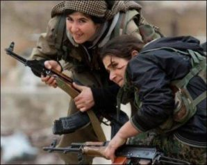 Female Kurdish fighters engaged in combat with ISIS in Jan 2015.