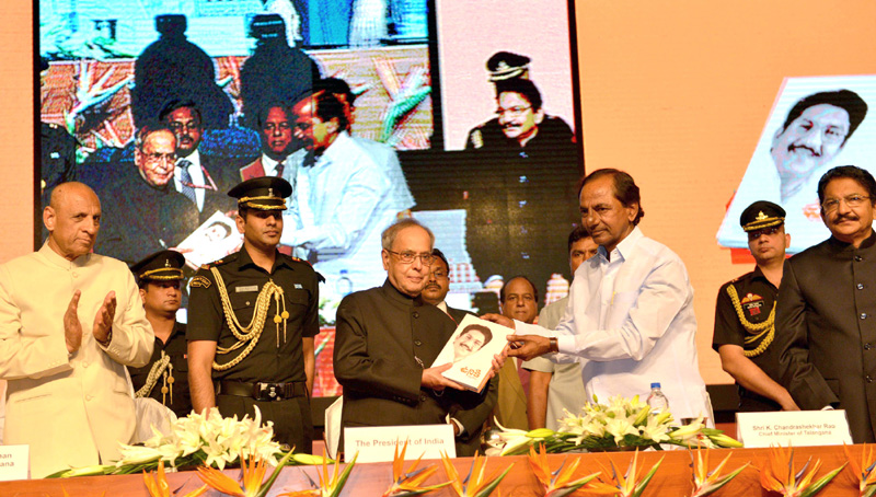 The President Mr Pranab Mukherjee Receiving The First Copy Of The Book Uniki