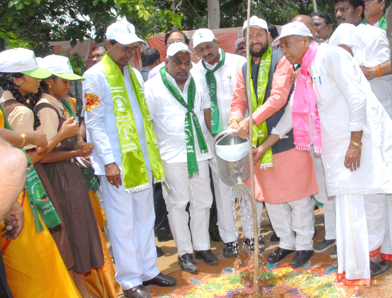 The Minister of State for Environment, Forest and Climate Change (Independent Charge), Mr. Prakash Javadekar planting a sapling, in Velpur Village, Nizamabad District, Telangana on July 06, 2015. The Chief Minister of Telangana, Mr. K. Chandrashekar Rao is also seen.
